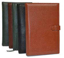 black, green, tan and camel colored leather notebooks